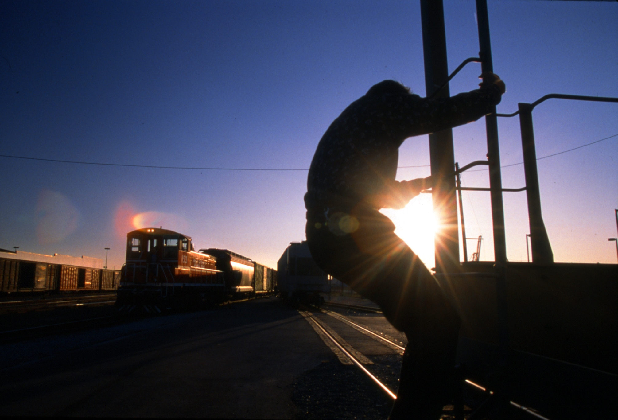 Railroad Worker at Sunset