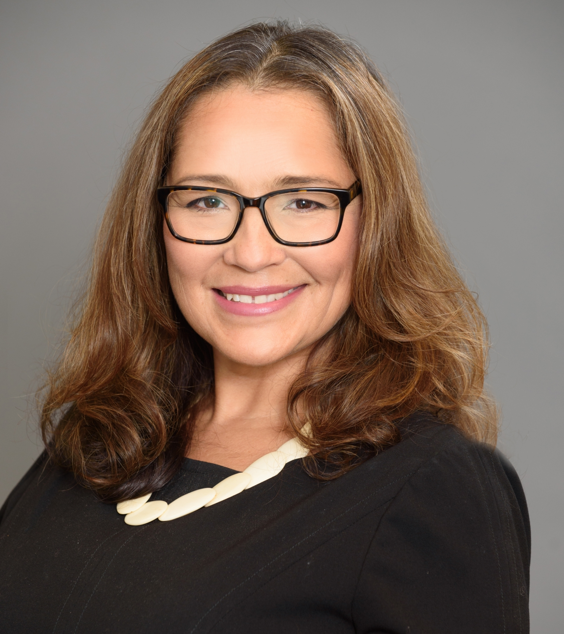 Headshot of Renee Aragon Dolese, Director of Marketing and Communications