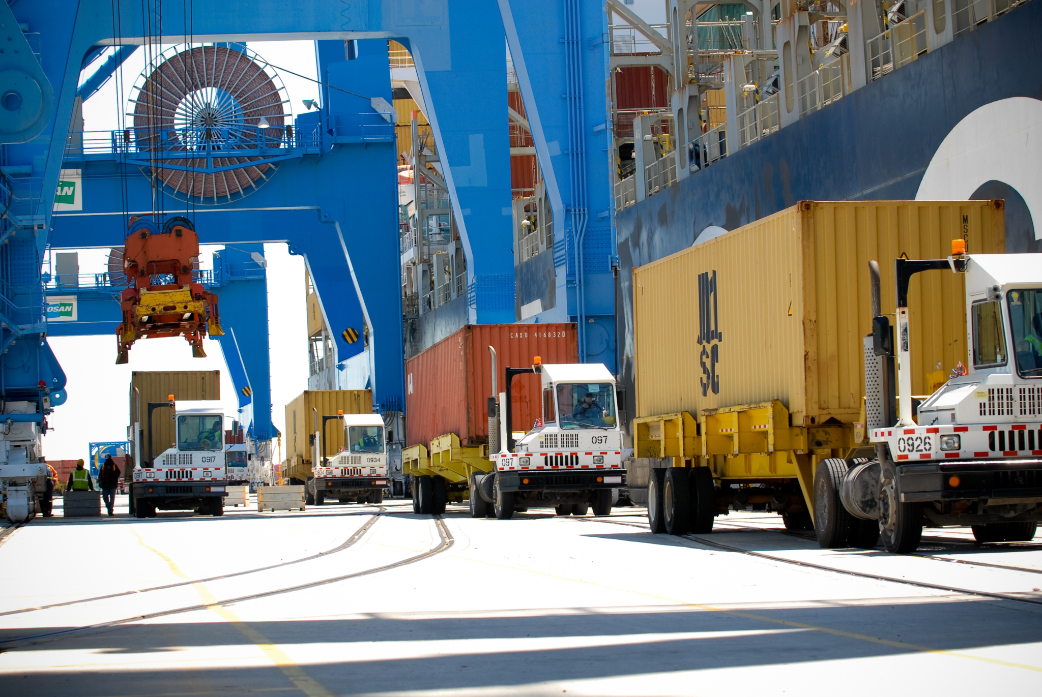 Gantry Cranes Loading Containers Onto Drayage Trucks